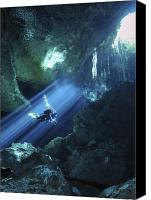 Maya Canvas Prints - Diver Silhouetted In Sunrays Of Cenote Canvas Print by Karen Doody