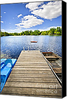 Rowboats Canvas Prints - Dock on lake in summer cottage country Canvas Print by Elena Elisseeva