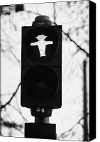 Crosswalk Canvas Prints - East German Ampelmannchen stopped traffic light man Berlin Germany Canvas Print by Joe Fox