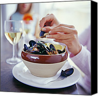 Dexterity Canvas Prints - Eating Mussels Canvas Print by David Munns