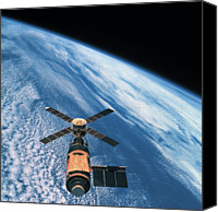 Astronomy Canvas Prints - Elevated View Of A Satellite Orbiting In Space Canvas Print by Stockbyte