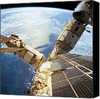 Astronomy Canvas Prints - Elevated View Of A Space Station In Orbit Canvas Print by Stockbyte