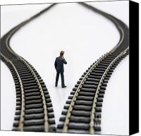 Rear Canvas Prints - Figurine between two tracks leading into different directions  symbolic image for making decisions Canvas Print by Bernard Jaubert