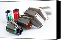 35mm Canvas Prints - Film and Canisters Canvas Print by Carlos Caetano