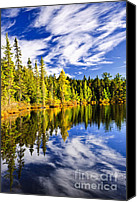 Evergreen Canvas Prints - Forest and sky reflecting in lake Canvas Print by Elena Elisseeva