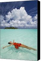 Carefree Canvas Prints - French Polynesia, Woman floating Canvas Print by Monica & Michael Sweet - Printscapes