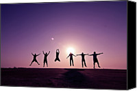 Outdoors Canvas Prints - Friends Jumping Against Sunset Canvas Print by Kazi Sudipto photography
