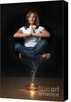Oil Lamp Canvas Prints - Genie levitation - woman floating in air over smoking oil lamp Canvas Print by Andre Babiak
