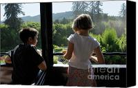 10:7 Canvas Prints - Girl and boy looking out of train window Canvas Print by Sami Sarkis