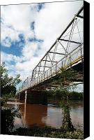 Bridge Crossing River Photo Canvas Prints - Going to Town Canvas Print by John Rizzuto
