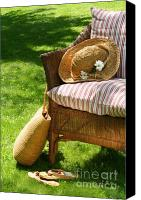 Lounge Canvas Prints - Grass lawn with a wicker chair  Canvas Print by Sandra Cunningham