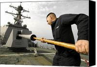 Warship Canvas Prints - Gunners Mate Cleans The Barrel Of An Canvas Print by Stocktrek Images