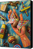 Fingers Photo Canvas Prints - Hand Holding Butterfly Toy Canvas Print by Garry Gay