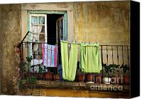 Peeling Canvas Prints - Hanged Clothes Canvas Print by Carlos Caetano