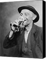 Glass Photo Canvas Prints - Happy Old Man Drinking Glass Of Beer Canvas Print by Everett