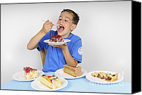 Torte Canvas Prints - Hungry boy eating lot of cake Canvas Print by Matthias Hauser