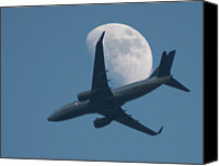 Gulf Coast States Canvas Prints - Jet In Front Of Moon Canvas Print by KM&G-Morris