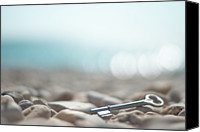 Lost Canvas Prints - Key On Pebbles Canvas Print by Alexandre Fundone