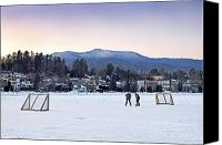 Hockey Canvas Prints - Kids playing hockey on Mirror Lake with Lake Placid Village shown in the background at sunset  Canvas Print by Brendan Reals