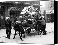 Civilians Canvas Prints - Korean War Civilians Loading A Cart Canvas Print by Everett