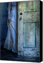 Creepy Canvas Prints - Lady in Vintage Clothing Hiding Behind Old Door Canvas Print by Jill Battaglia