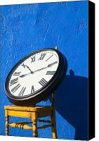 Minutes Photo Canvas Prints - Large clock on yellow chair Canvas Print by Garry Gay
