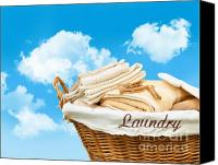 Household Canvas Prints - Laundry basket  against a blue sky Canvas Print by Sandra Cunningham