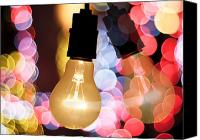 Decorate Canvas Prints - Light Bulb And Bokeh Canvas Print by Setsiri Silapasuwanchai