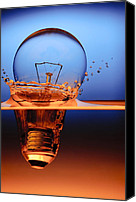 Featured Canvas Prints - Light Bulb And Splash Water Canvas Print by Setsiri Silapasuwanchai