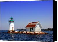 Waterway Canvas Prints - Lighthouse on the St Lawrence River Canvas Print by Olivier Le Queinec