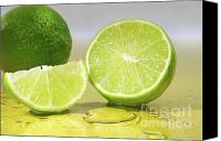 Cube Canvas Prints - Limes on yellow surface Canvas Print by Sandra Cunningham