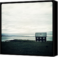 Relaxing Canvas Prints - Little Black House By The Sea Canvas Print by Luke Kingma