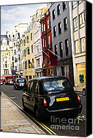 Taxi Canvas Prints - London taxi on shopping street Canvas Print by Elena Elisseeva