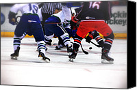 Skates Photo Canvas Prints - Loose Puck Canvas Print by Karol  Livote