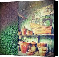 Shed Canvas Prints - Lots of different size pots in the shed Canvas Print by Sandra Cunningham