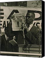 Malcolm X Canvas Prints - Malcolm X, Holding Up Newspaper Canvas Print by Everett