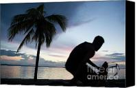 Cienfuegos Canvas Prints - Man cycling along the waterfront at sunset Canvas Print by Sami Sarkis