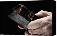 Praying Canvas Prints - Man Hands Holding Old Bible Canvas Print by Olivier Le Queinec