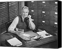 Talking Canvas Prints - Man Sitting At Desk, Talking On Phone, (b&w), Elevated View Canvas Print by George Marks