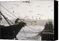 Moroccan Canvas Prints - Man Throwing Rope To People On Dockside Canvas Print by Axiom Photographic