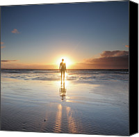 Solitude Canvas Prints - Man Walking On Beach At Sunset Canvas Print by Stu Meech