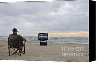 Tv Set Canvas Prints - Man watching TV on beach at sunset Canvas Print by Sami Sarkis