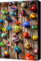 Spheres Canvas Prints - Marbles on wooden board Canvas Print by Garry Gay
