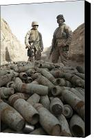Unused Canvas Prints - Marines Stand Over A Pile Of Unused Canvas Print by Stocktrek Images