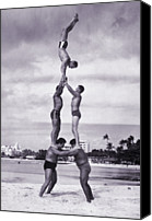Arts Edge Canvas Prints - Men And Girl Perform Acrobatics On Beach Canvas Print by Archive Holdings Inc.