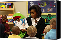 Michelle Obama Photo Canvas Prints - Michelle Obama Reads The Cat In The Hat Canvas Print by Everett