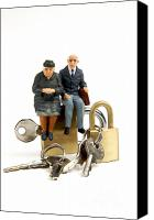 Scared Canvas Prints - Miniature figurines of elderly couple sitting on padlocks Canvas Print by Bernard Jaubert