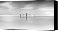 Wooden Post Canvas Prints - Minimal Posts Are Arranged Symmetrically In Sea Canvas Print by Doug Chinnery