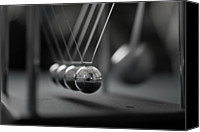 Shiny Photo Canvas Prints - Newtons Cradle In Motion - Metallic Balls Canvas Print by N.J. Simrick