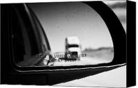Wing Mirror Canvas Prints - objects in mirror are closer than they appear in car side mirror with truck on highway Canada Canvas Print by Joe Fox